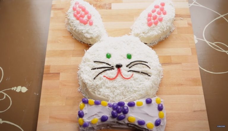 Easter cakes are often shaped like bunnies and this one is no different. Photo is a bunny cake with a bow tie decorates with candy.