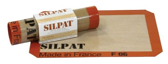 Silpat brand Silcione Mat with red edges that have the words made in France on them