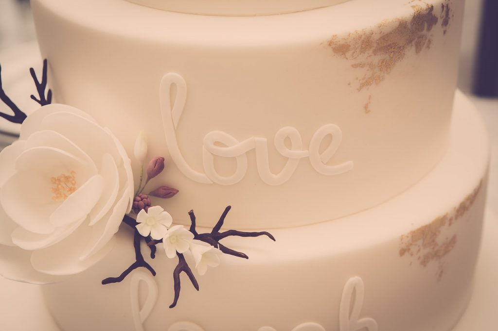 A wedding cake with the word love written on it