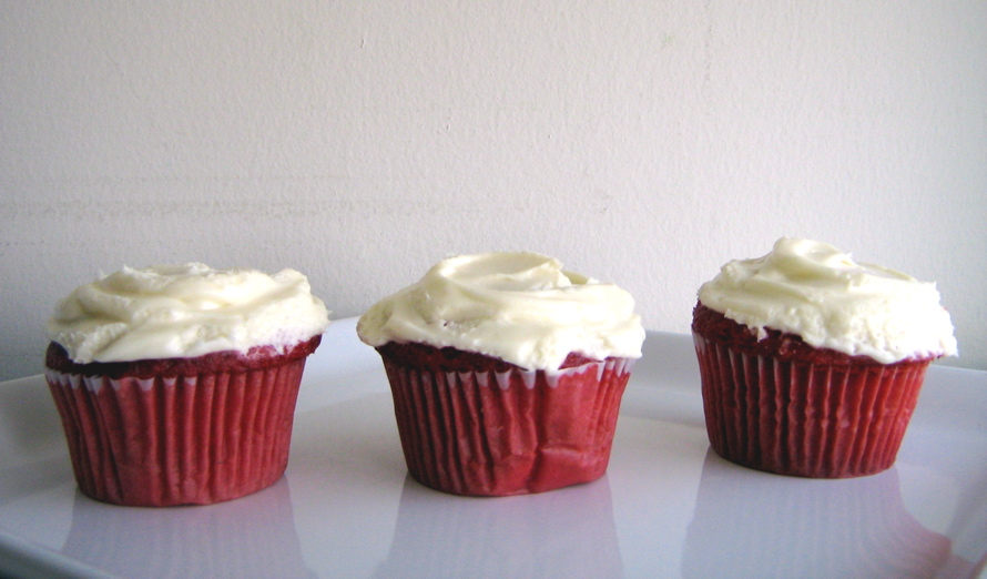 red velvet cupcakes with cream cheese on top