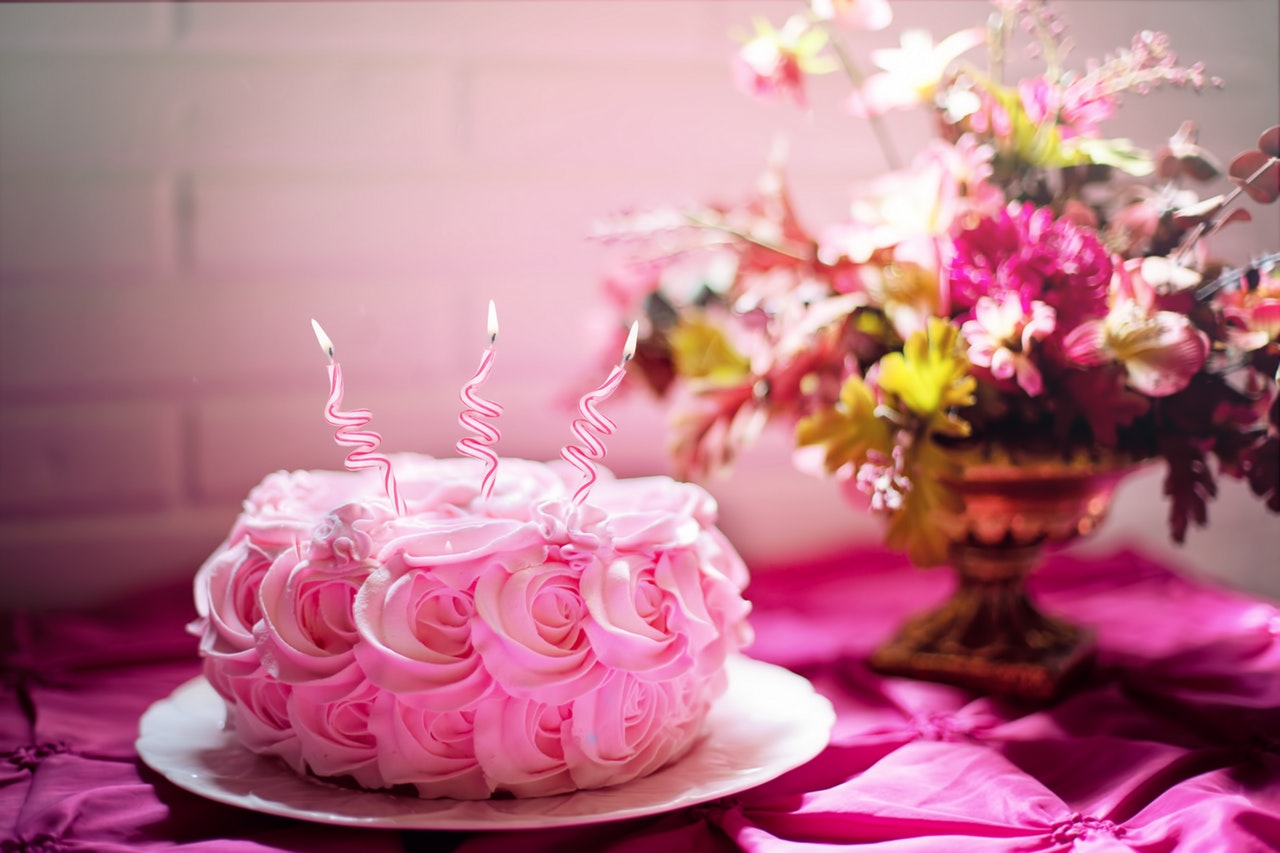 pink smash cake with candles